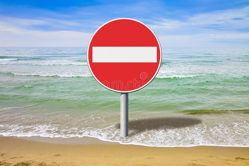 Bathing prohibition - concept image with road sign stock images