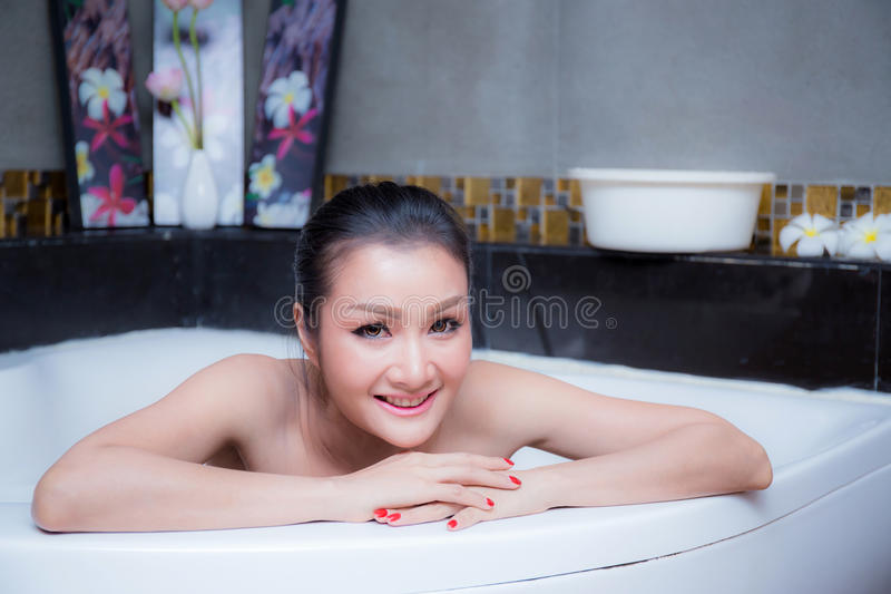 Bathing woman relaxing in bath smiling relax. royalty free stock images