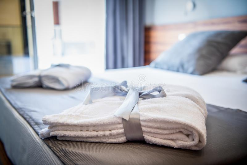 Bathrobe on bed in a luxury hotel room stock image