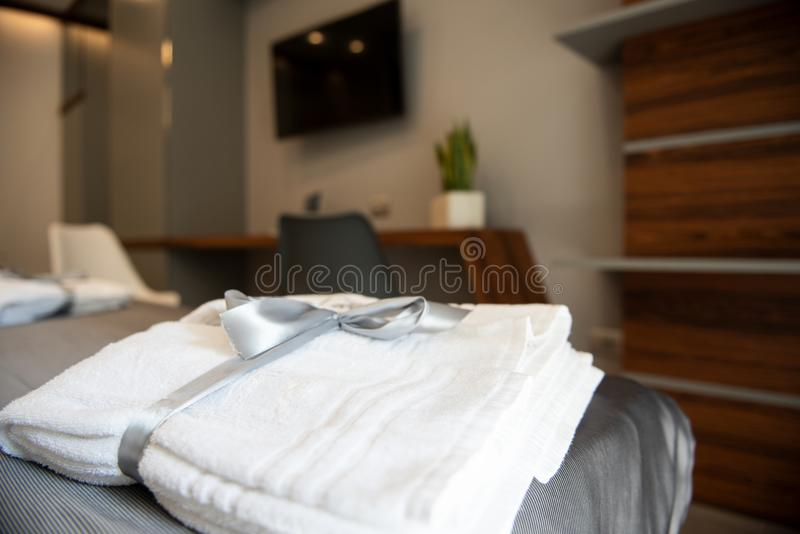 Bathrobe on bed in a luxury hotel room royalty free stock images