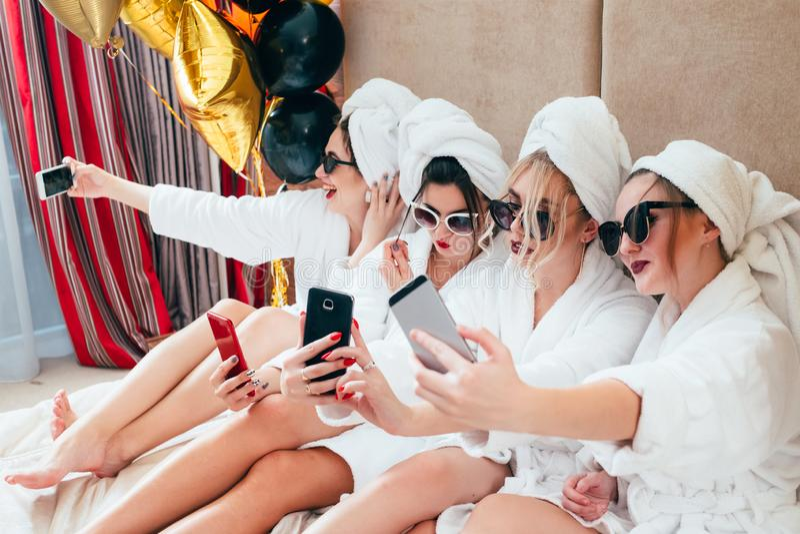 Bathrobe girls party selfie joy fun lifestyle royalty free stock image