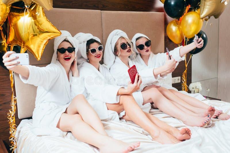 Bathrobe party girls selfie leisure lifestyle stock photo
