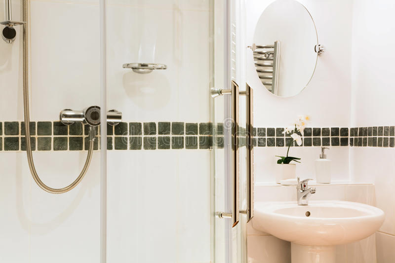 Bathroom. Modern luxury bathroom with contemporary white tiles shower and basin royalty free stock images