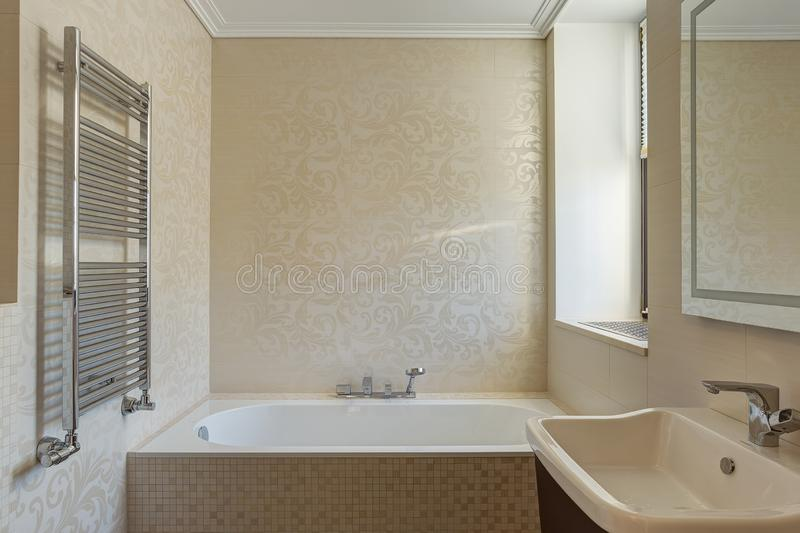 Bathroom in beige and white colors. stock image