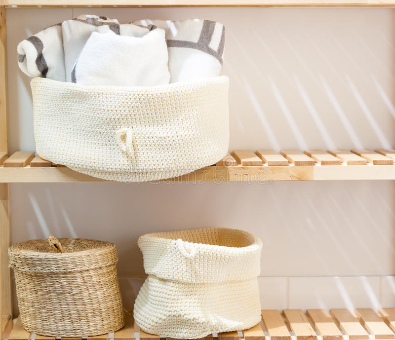 Bathroom closet shelves. Wooden shelves of a closet in a bathroom with things royalty free stock image