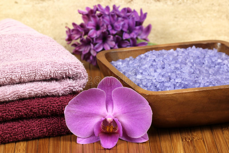 Bathroom composition. Spa relaxation composition - bath soap, towels, orchid flower royalty free stock images
