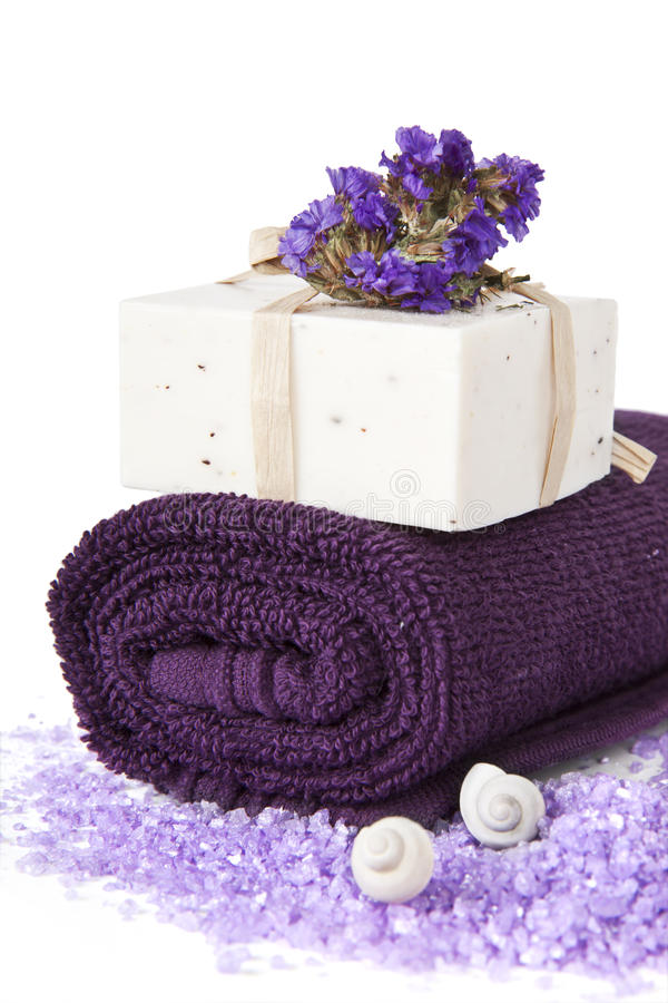 Bathroom composition. Soap Bars and violet towel with flower isolated. Bathroom composition stock photo