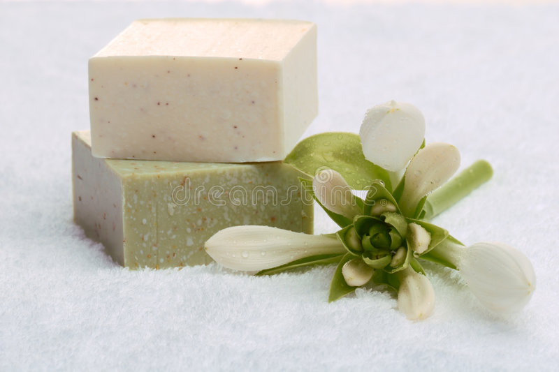 Bathroom composition. Soap Bars and white towels with flower. Bathroom composition stock photos