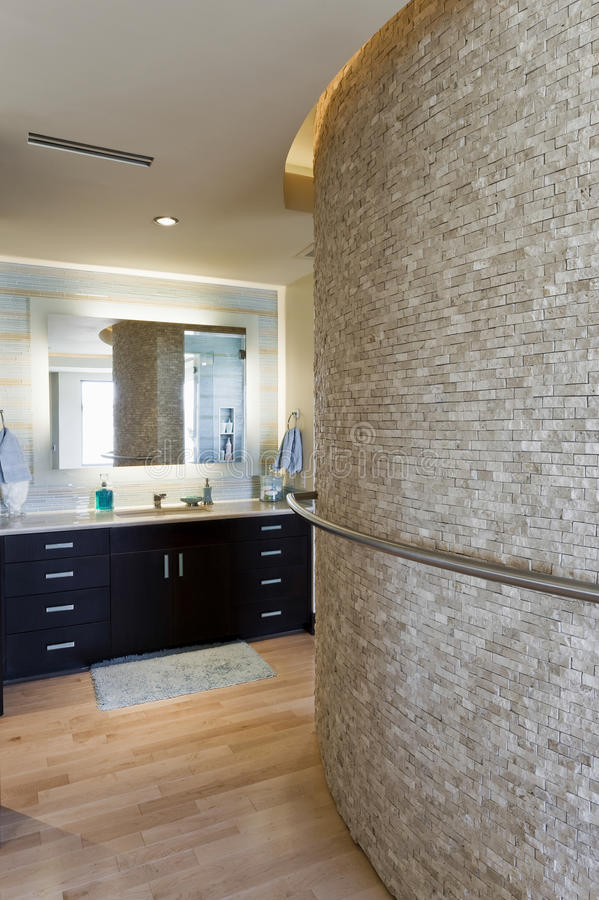 Bathroom with curved stone wall and cabinets royalty free stock photo image 33907575 for Contemporary bathroom wall cabinets