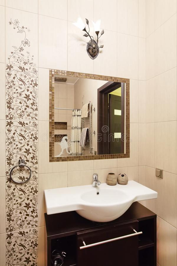 Bathroom design in golden and brown colors royalty free stock photography