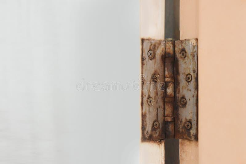 Bathroom door hinge rust. On the door of PVC waterproof and empty space for text. stock photos