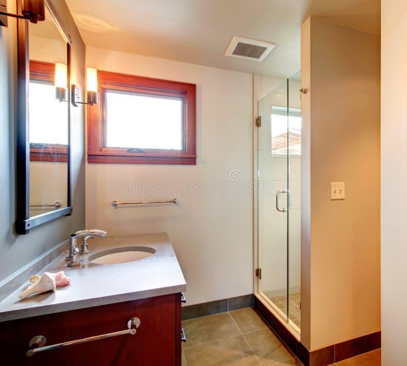Bathroom with glass door shower stock photos