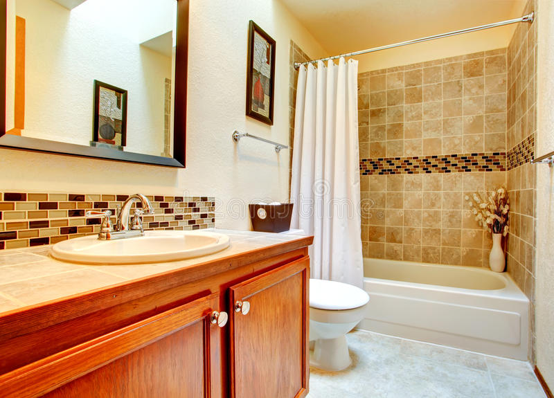 Bathroom Interior With Beige Tile Wall Trim Stock Photo
