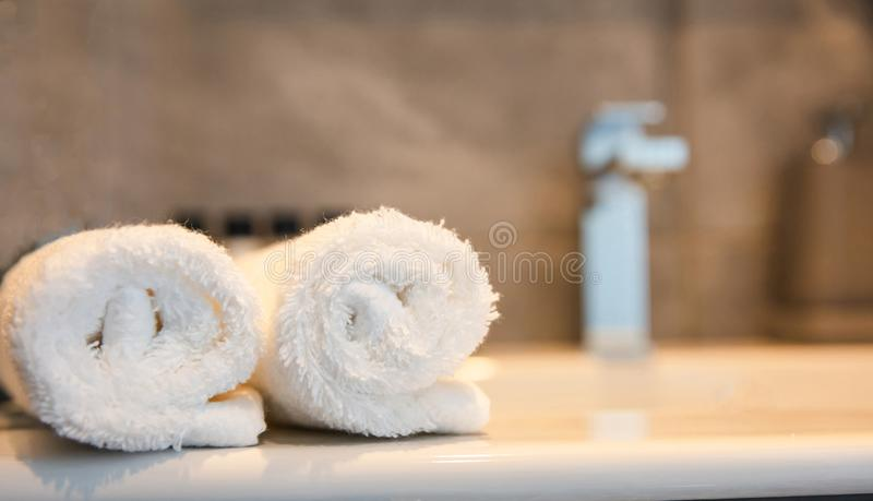 Luxury bathroom sink and white towels. Closeup view with details royalty free stock image