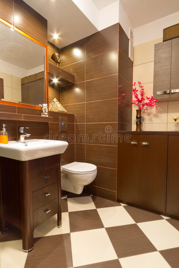Bathroom interior with brown and beige tiles royalty free stock photos