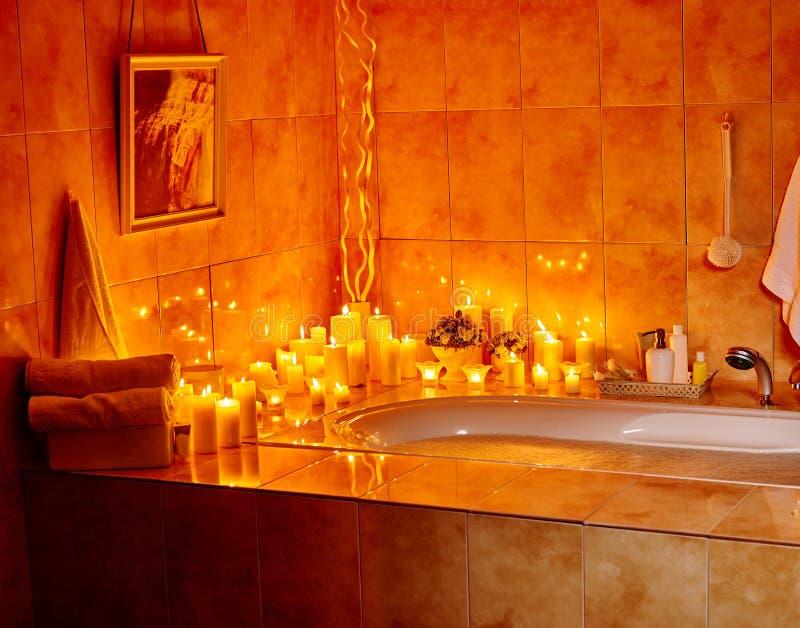 Bathroom interior with bubble bath. Home bathroom interior with bubble bath. Burning candels stock photos