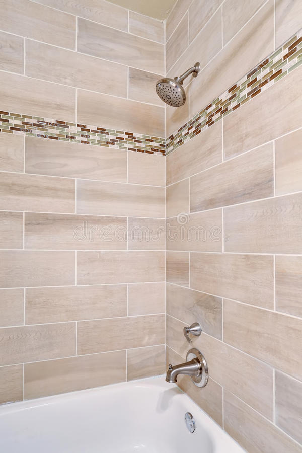 Bathroom interior design. View of open shower with tile wall trim. Northwest, USA stock photo