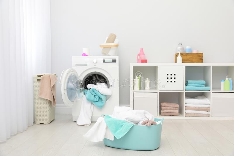 Bathroom interior with dirty towels in basket. And washing machine stock image