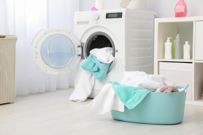 Bathroom interior with dirty towels in basket. And washing machine stock photos