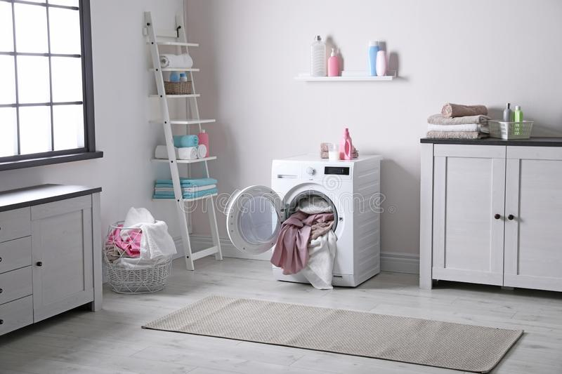 Bathroom interior with dirty towels. In washing machine stock images