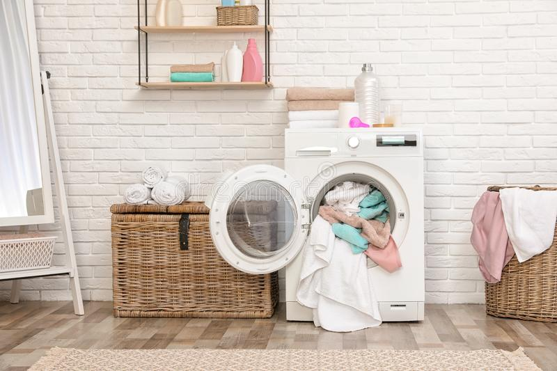 Bathroom interior with dirty towels. In washing machine stock photography