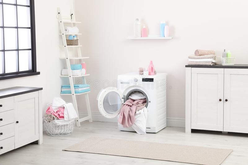 Bathroom interior with dirty towels. In washing machine stock photo