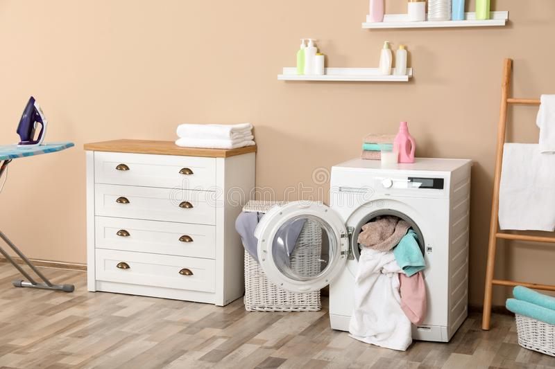 Bathroom interior with dirty towels. In washing machine royalty free stock photo