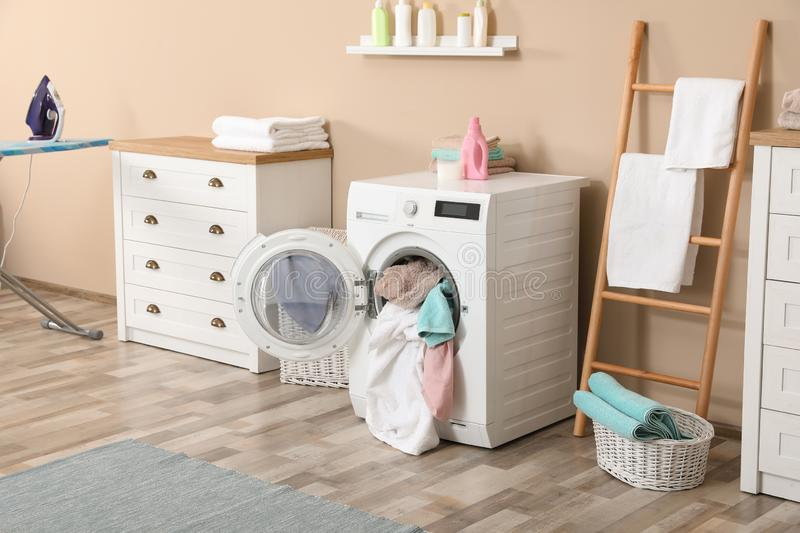 Bathroom interior with towels in washing machine. Bathroom interior with dirty towels in washing machine royalty free stock photography