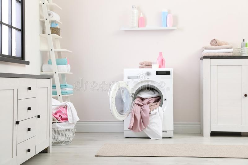 Bathroom interior with towels in washing machine. Bathroom interior with dirty towels in washing machine royalty free stock image