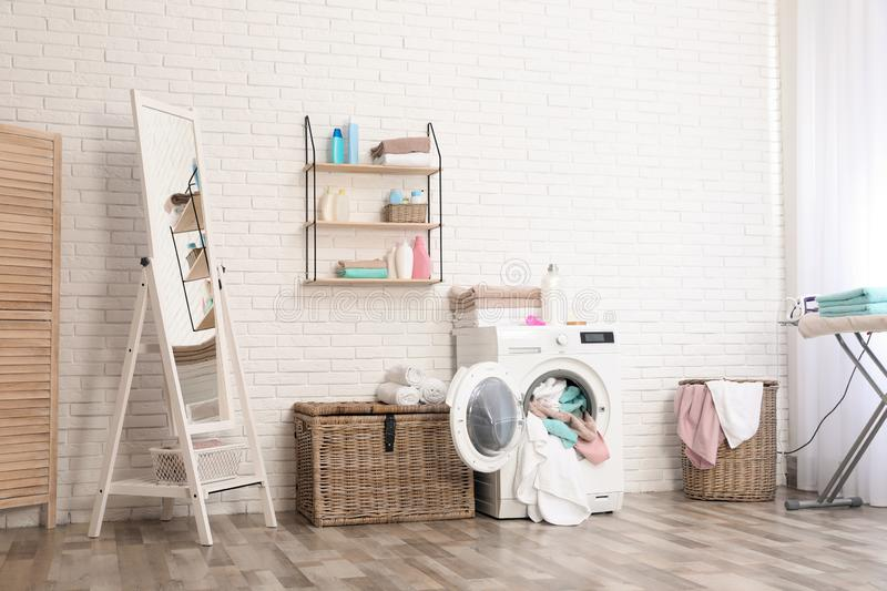 Bathroom interior with towels in washing machine. Bathroom interior with dirty towels in washing machine royalty free stock photos