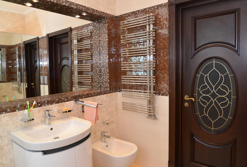 Bathroom interior fragment with a mirror niche.  royalty free stock images