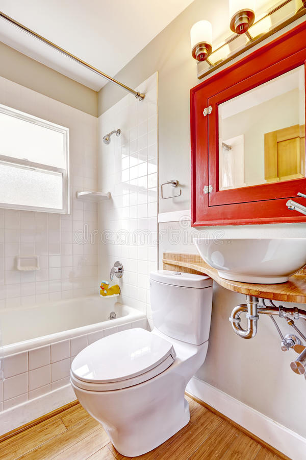 Free Bathroom Interior. Red Cabinet With Mirror And White Vessel Sink Royalty Free Stock Photography - 44603897