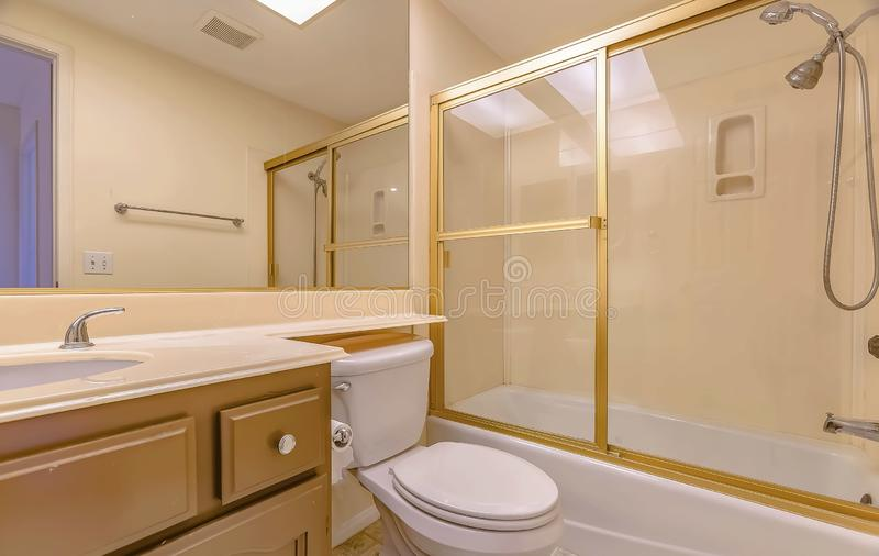 Bathroom interior with sink cabinet and toilet below the large mirror royalty free stock photography