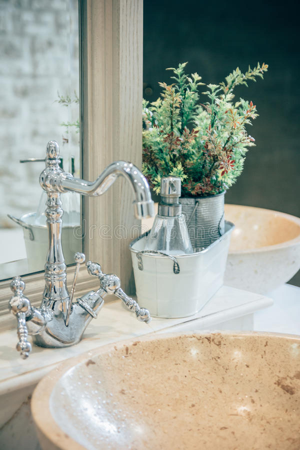 Bathroom interior with sink and faucet royalty free stock image