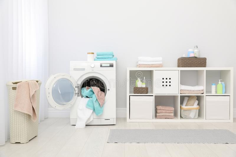 Bathroom interior with towels. And washing machine stock photos