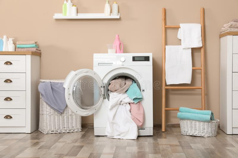 Bathroom interior with towels in washing machine. Bathroom interior with dirty towels in washing machine stock images