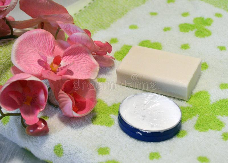 Bathroom items with orchid flower royalty free stock image
