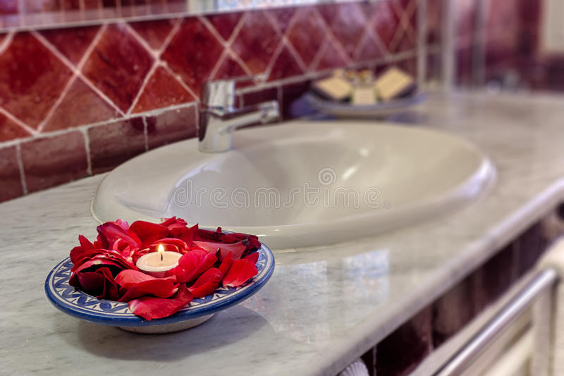 Bathroom. Luxury bathroom with petals and candle decoration royalty free stock photo