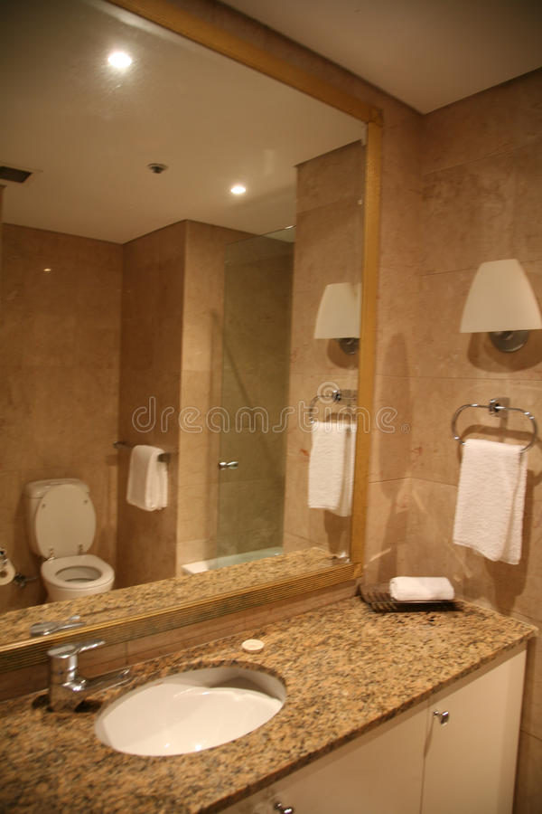 Bathroom in marble. Bathroom made of marble and reflected the toliet, hotel or home related stock photo