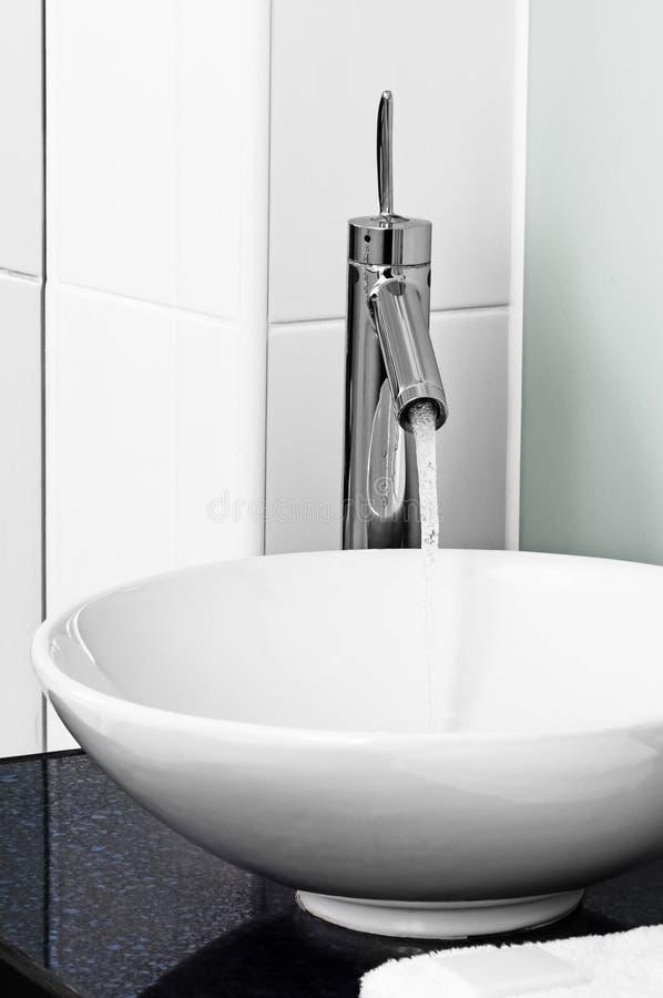Bathroom modern contemporary stilish sink basin faucet tap ceramic water on stock photos