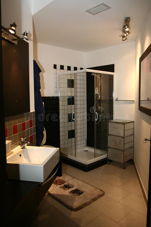 Bathroom in new apartment with sink and shower stock images
