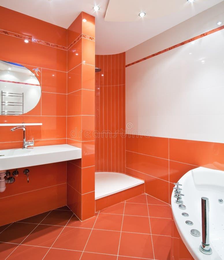 White Bathroom Orange Floor : Bathroom in orange and white colors stock image