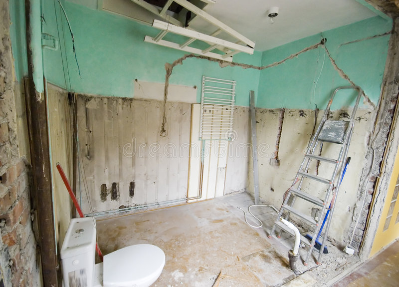 Bathroom renovation. The first stage of a bathroom being renovated, walls and tiles torn down, mess all around. Part of 'home renovation' project, see my stock images