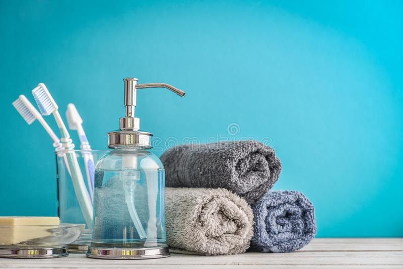 Bathroom set with toothbrushes, towels and soap. On blue background stock images