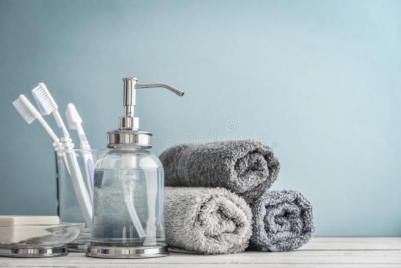 Bathroom set with toothbrushes, towels and soap. On blue background stock photos