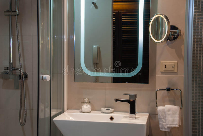 Bathroom. Simple modern bathroom,including separate shower in glass wall, wash basin and Mirror stock images