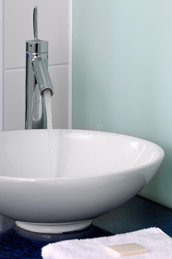 Bathroom sink bowl counter tap mixer towel soap stock photo