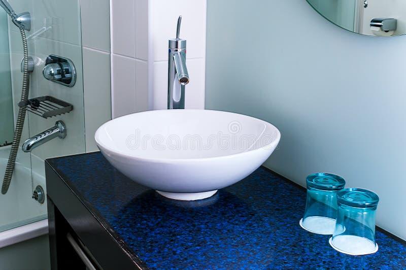 Bathroom sink counter tap mixer glass blue stock photos