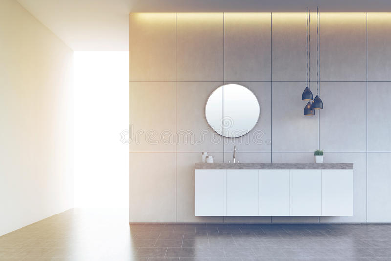 Bathroom sink with round mirror on tiled wall, concrete floor, t. Bathroom interior with a tiled wall, concrete floor, a round mirror and a long sink counter. 3d stock illustration