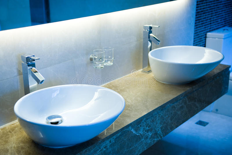 Bathroom sinks. A view of bathroom with two sinks stock photo